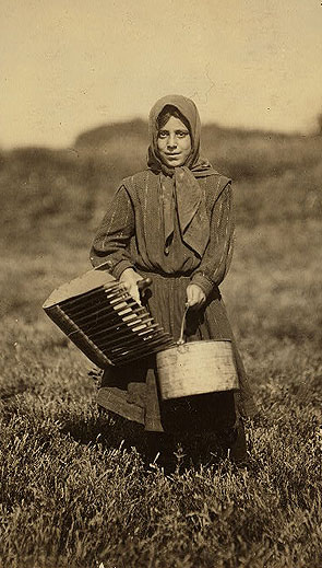 Carrie Maderyos, 12 years old, ready to pick at Swifts Bog, Falmouth, 1911. Photo courtesy the Library of Congress.