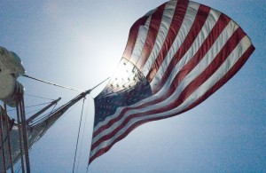 Stars and Stripes Flying on a Military Tallship