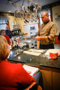 Cape Cod Cooking Getaway preparing to cut the dough.
