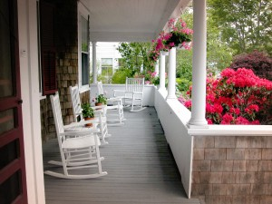 Rocking chairs and hanging flower baskets on the porch.