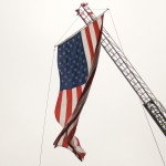 US Flag hanging from a crane for Memorial Day Weekend on Cape Cod