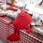 Smiling strawberry toy on a table at the Strawberry Festival 2012.