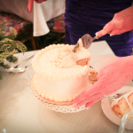 Cutting the winter wedding elopement cake