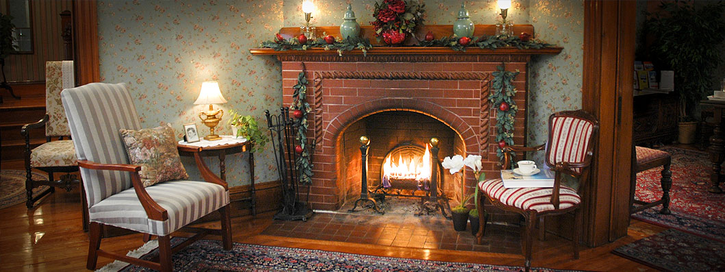 Cozy fireplace with a mantle decorates for the holidays