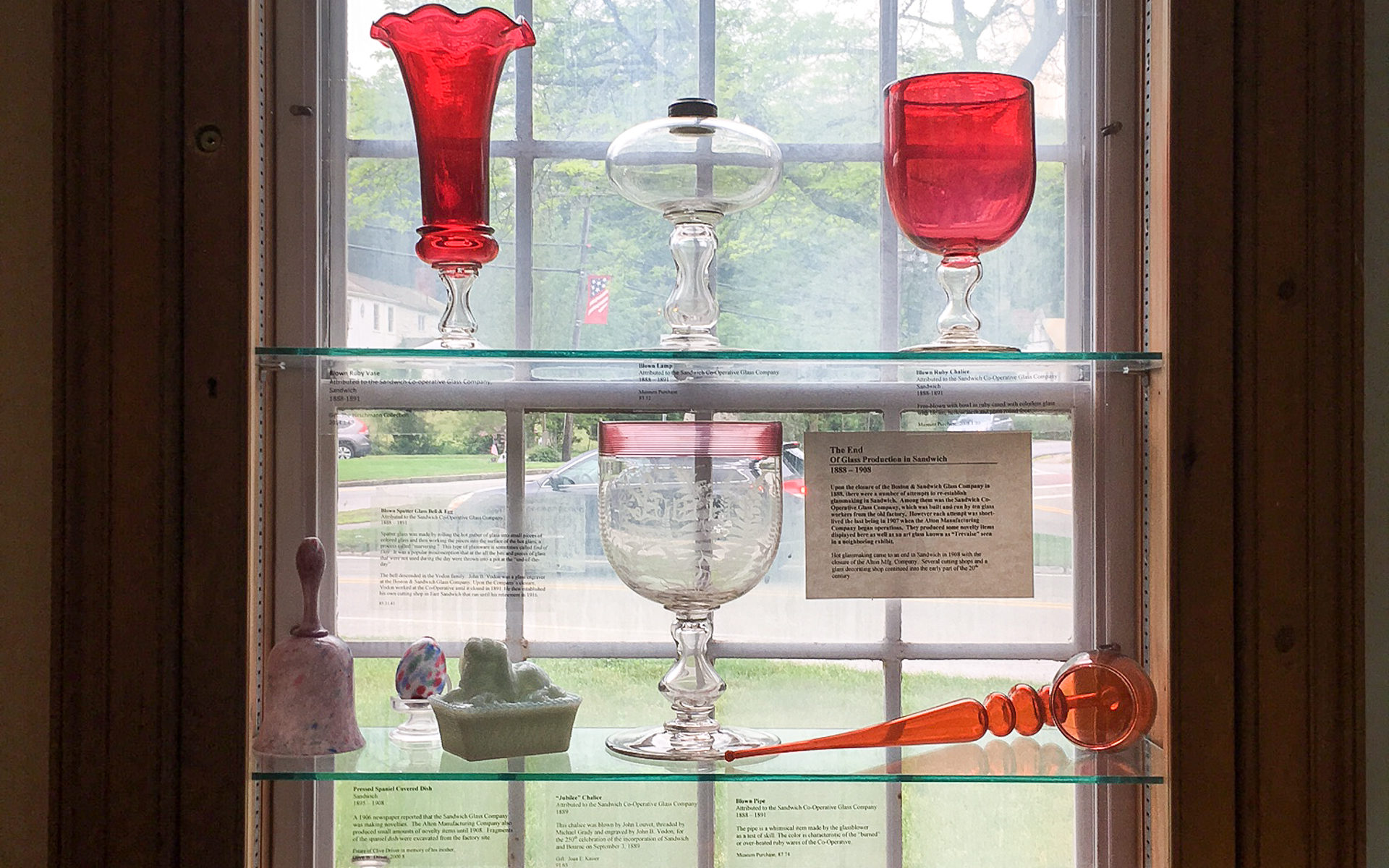 Red Glass Display at the Sandwich Glass Museum in Sandwich, Massachusetts, USA.