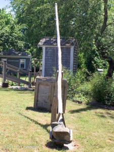 The well, where all of the water was drawn. Notice the leveraged pole with the stone as a counterweight. The Josiah Dennis Manse Museum on Cape Cod, New England, USA.