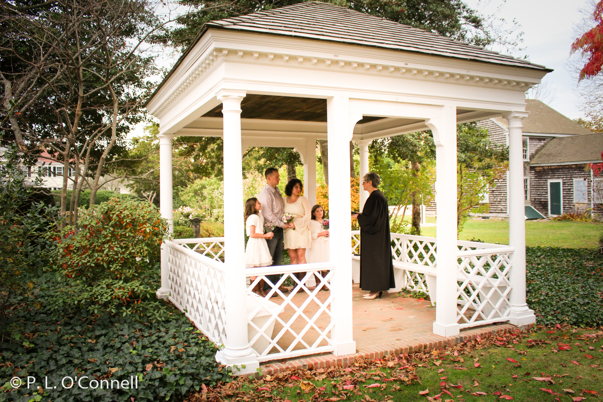 Wedding ceremony in the gazebo at the Museums on the Green in Falmouth, Cape Cod, Massachusetts, USA.