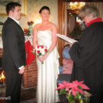 Winter wedding vows by the fireplace