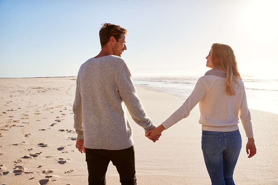 couple walking down the beach on Cape Cod
