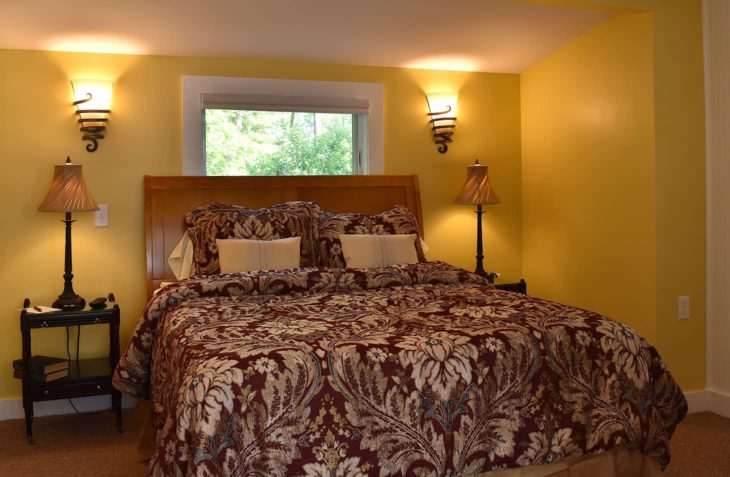 Wide queen bed in our romantic MA Bed & Breakfast