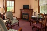 Room 5 - Emily Dickinson Room sitting area with fireplace at our Cape Cod B&B