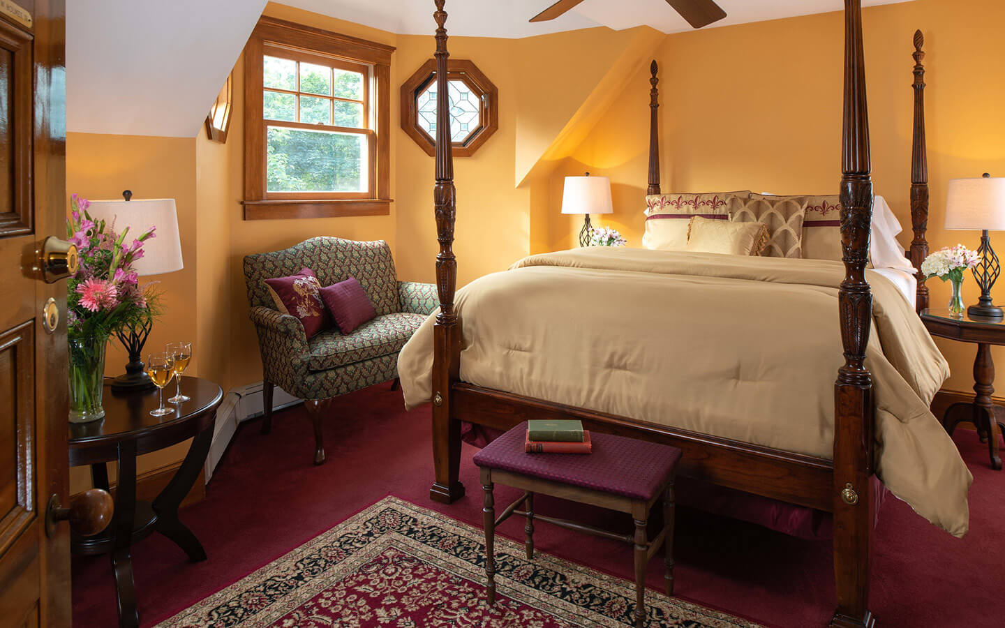Oliver Wendell Holmes Room bed and seating at our Falmouth, MA bed and breakfast