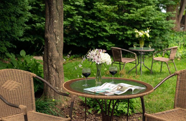 Outdoor table with wine glasses at the best B&B in Cape Cod