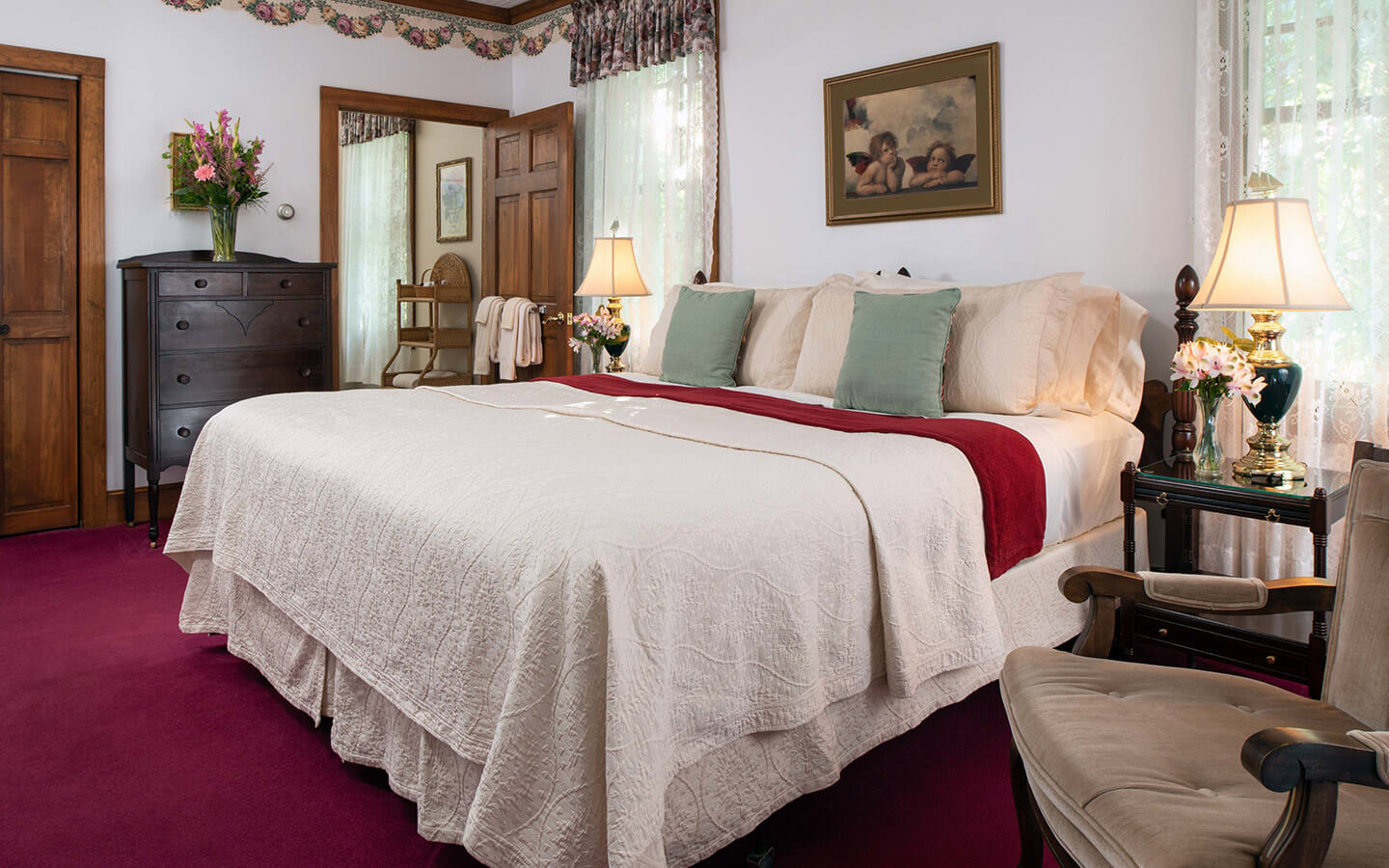 Room D - Walt Whitman Room bed and chair at our Cape Cod B&B
