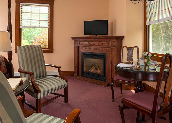 Emily Dickinson Room seating area with fireplace