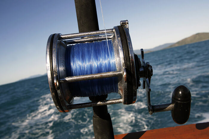 Closeup of a reel on a fishing pole in Falmouth, MA