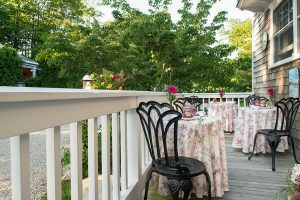 Dining on the porch at our B&B in Cape Cod, MA