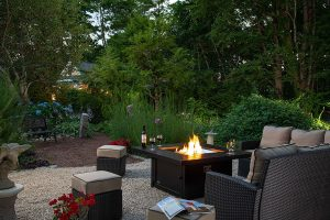 Firepit and seating area in the garden at our Cape Cod, MA bed and breakfast