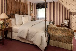 Henry James Penthouse bed at our Cape Cod B&B