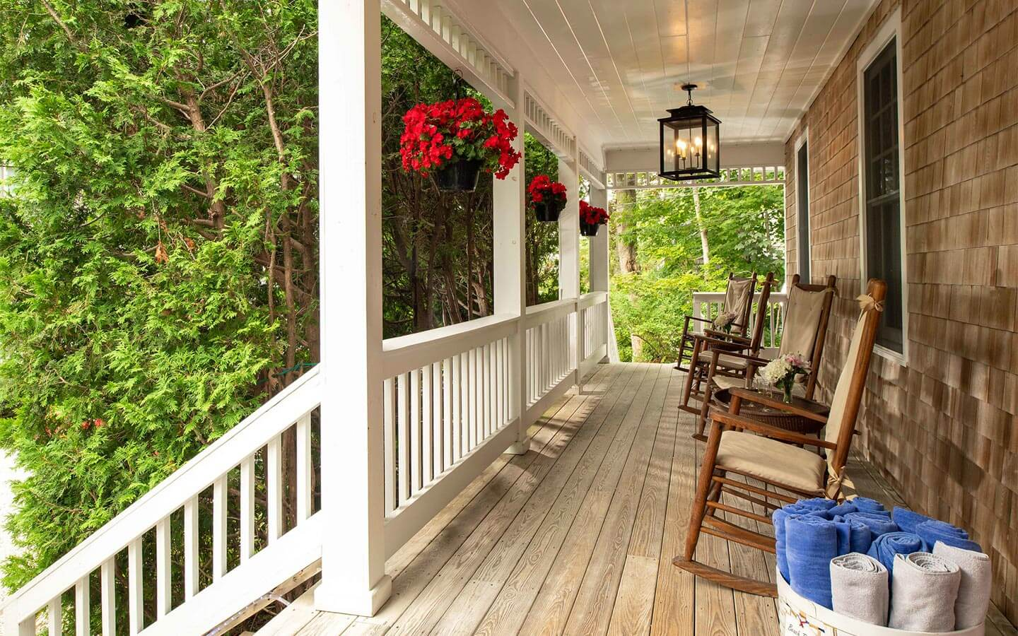 Front porch with rocking chairs at our bed and breakfast in Falmouth, MA