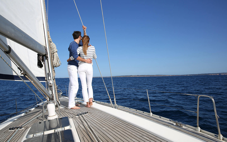 Couple on a sail boat in Cape Cod, MA