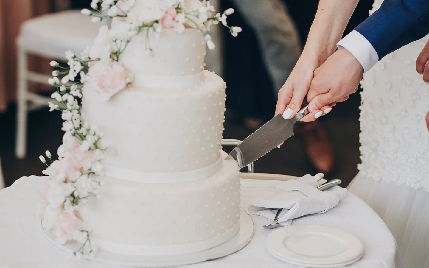 Cake cutting at a wedding in Cape Cod