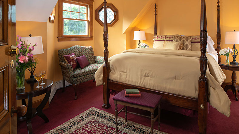 Cozy guest room at Palmer House Inn