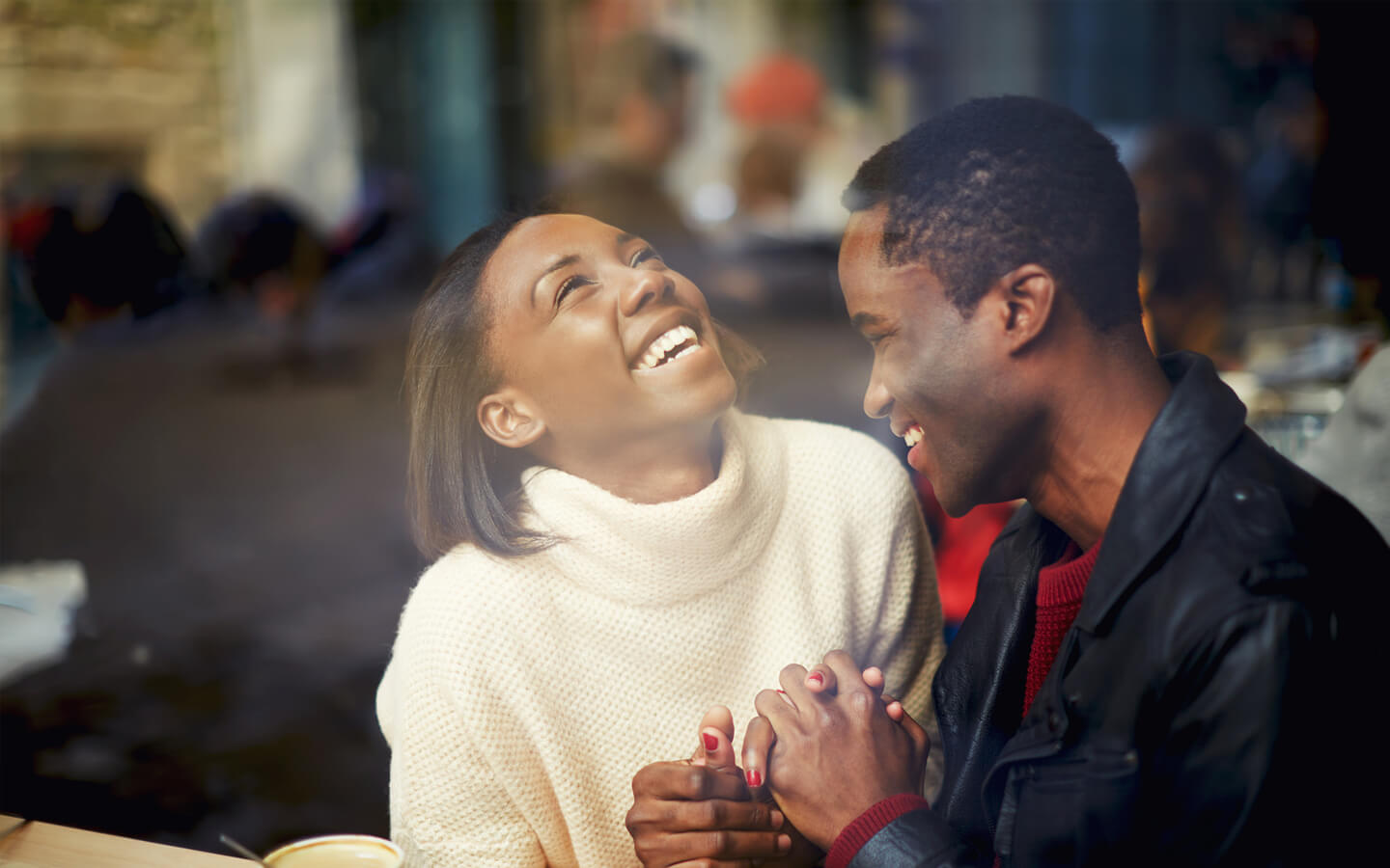 African American in love couple holding hands and laughing