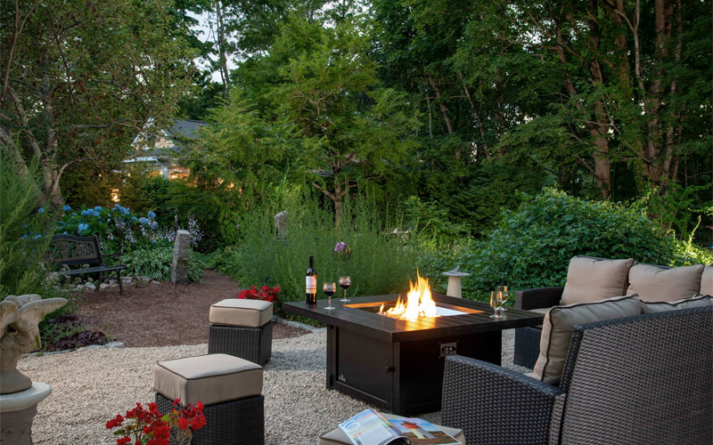 Cozy fire pit in a garden with couch