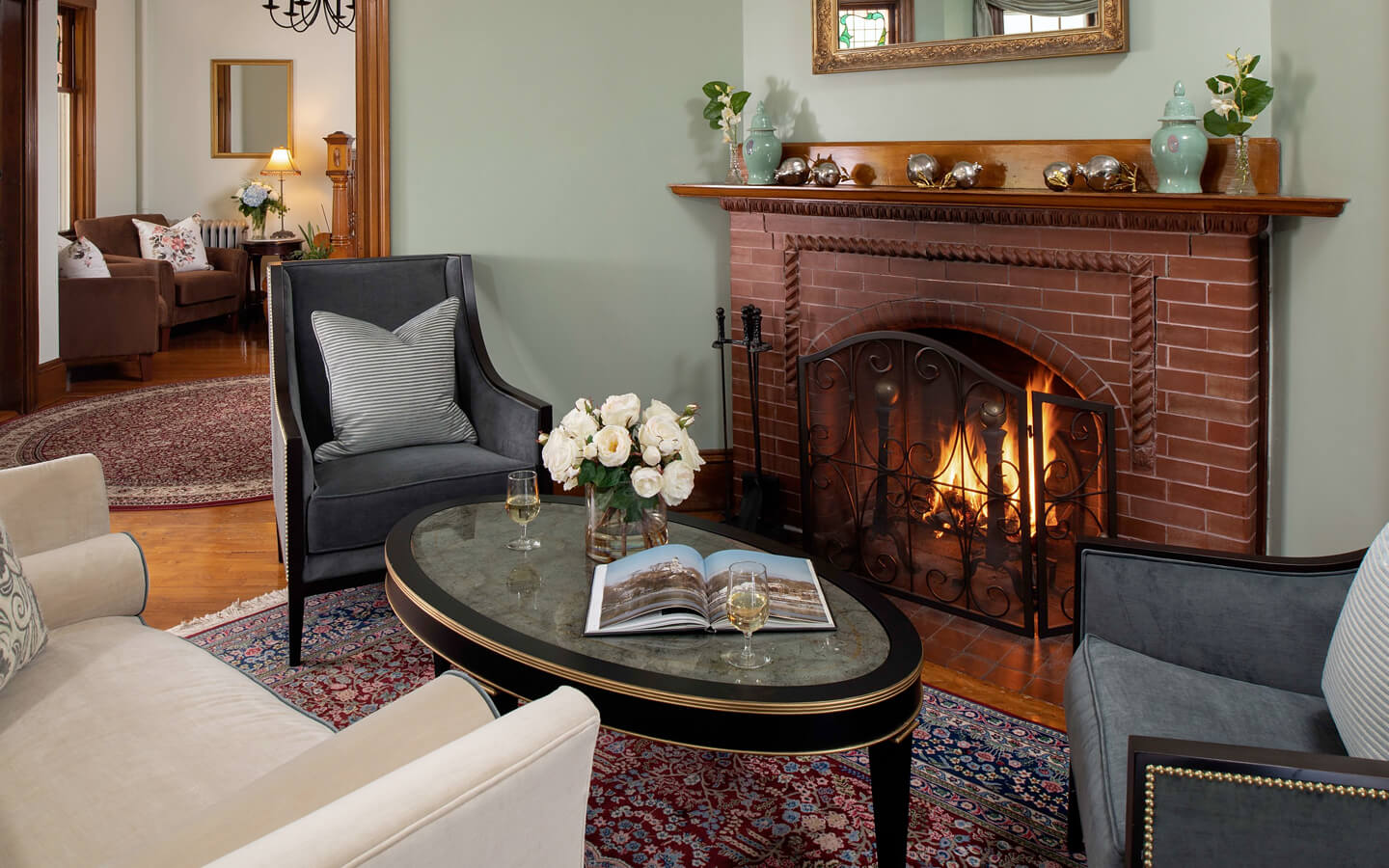 Clean and modern parlor with fireplace