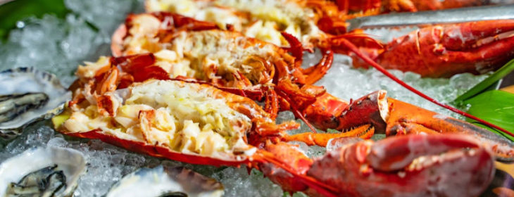 Half lobsters on ice with other shellfish