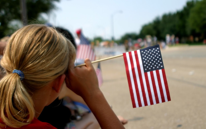 a woman with an american flag at a parade