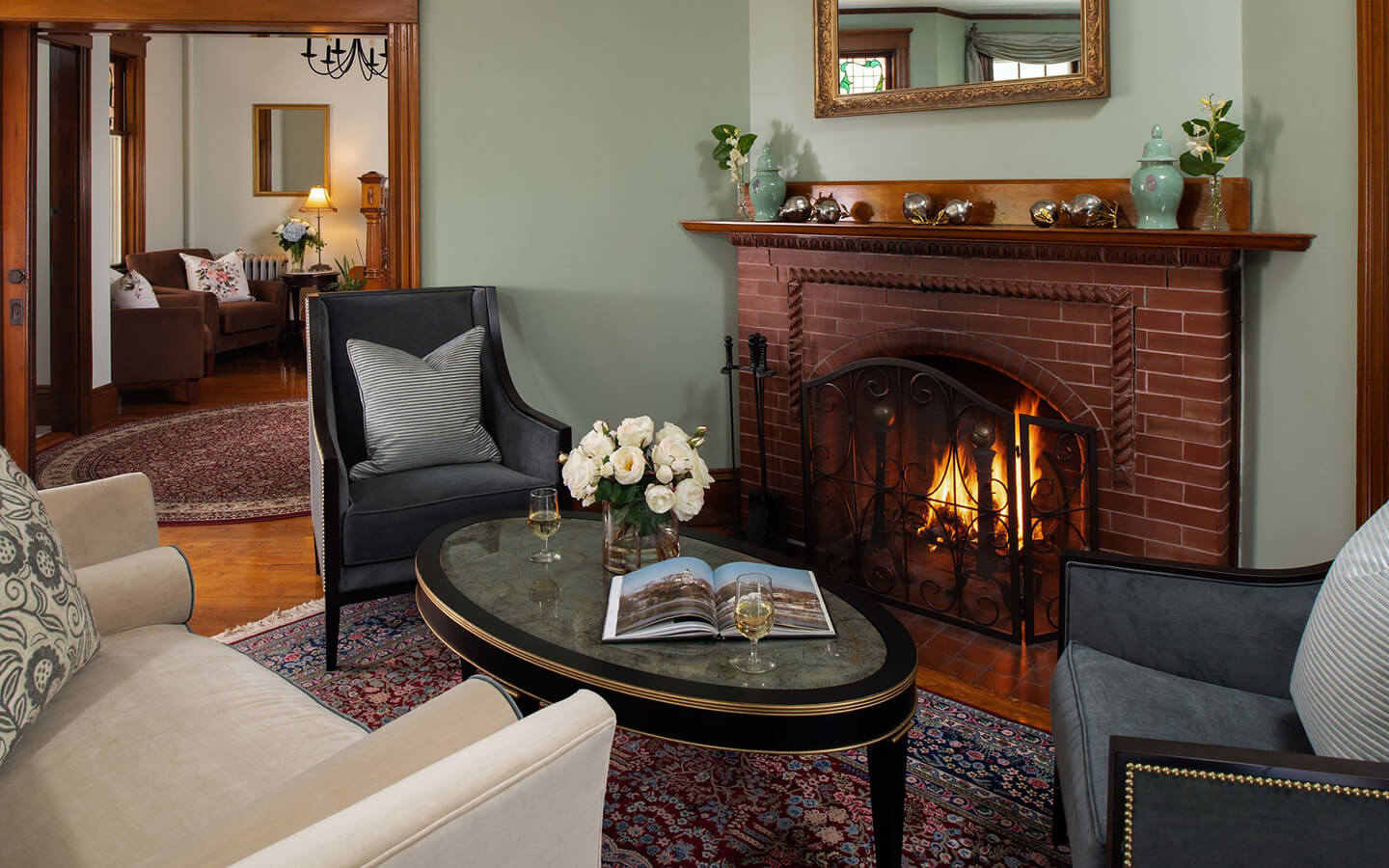 Sitting room with table and fireplace