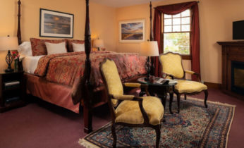 Emily Dickinson Room bed and seating area at our Falmouth, MA Bed and Breakfast